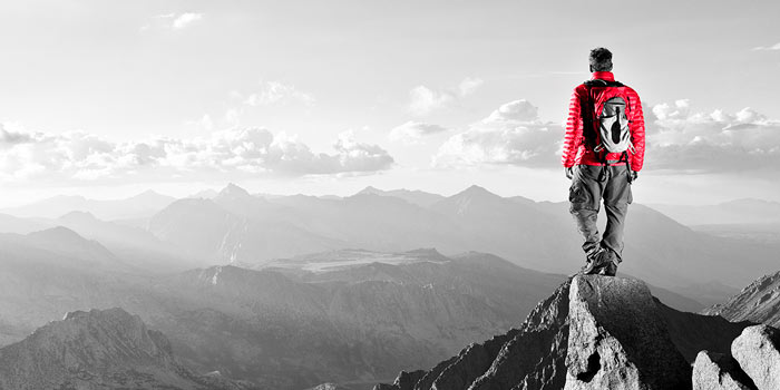 Man standing on a mountain | Atradius