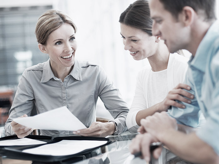 Business people looking at papers | Atradius
